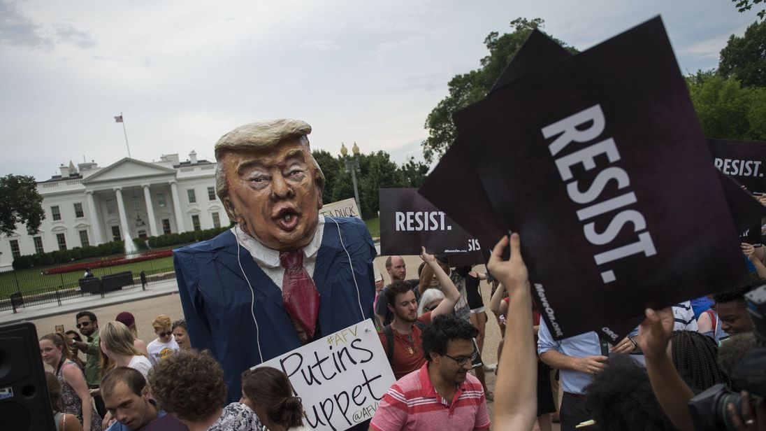 Protesters brand Mr Trump 'Putin's puppet&#39 during a protest outside the White House