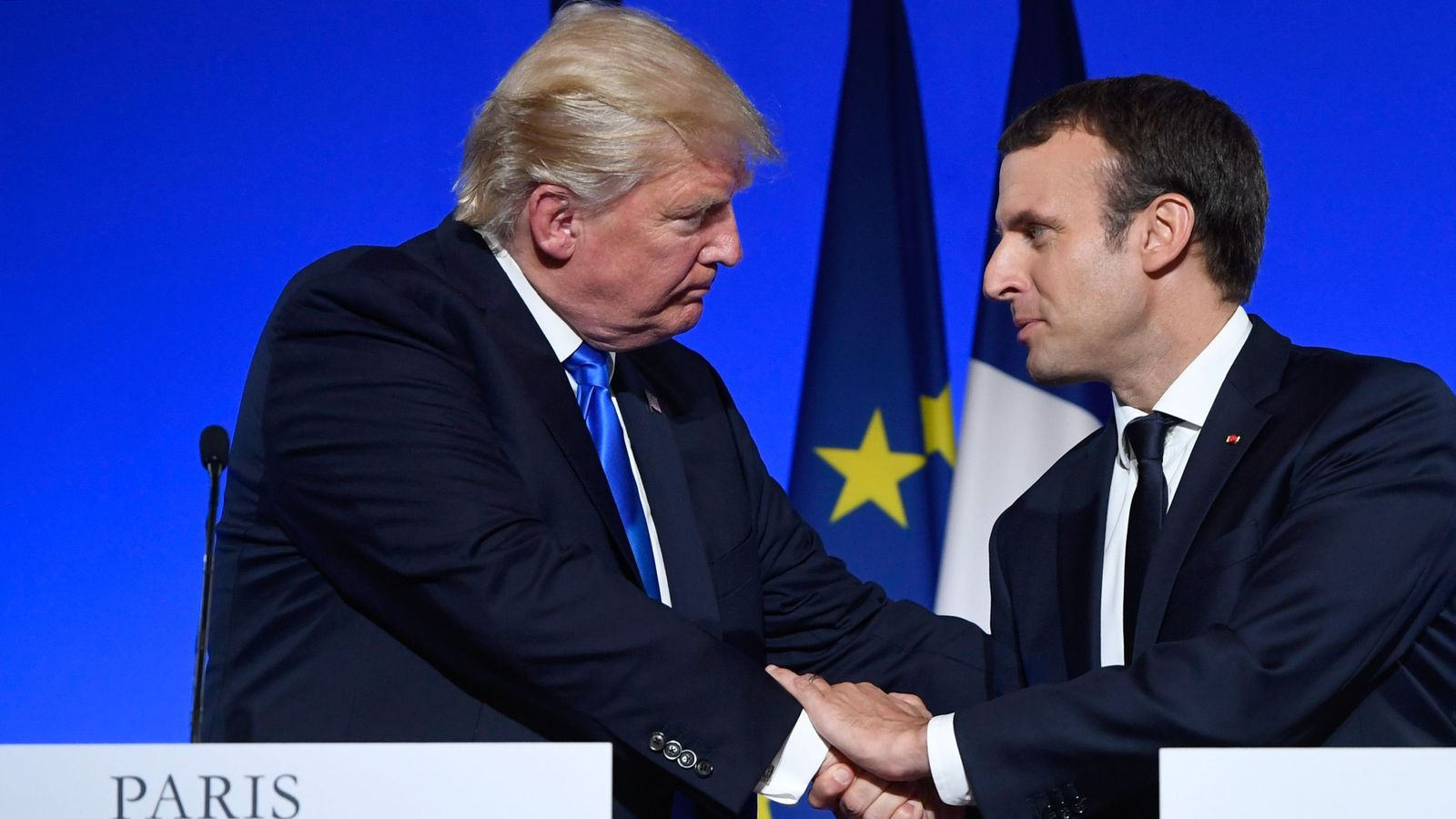 Visiting French president, Trump publicly downplays furor at home over Russian Federation  connections