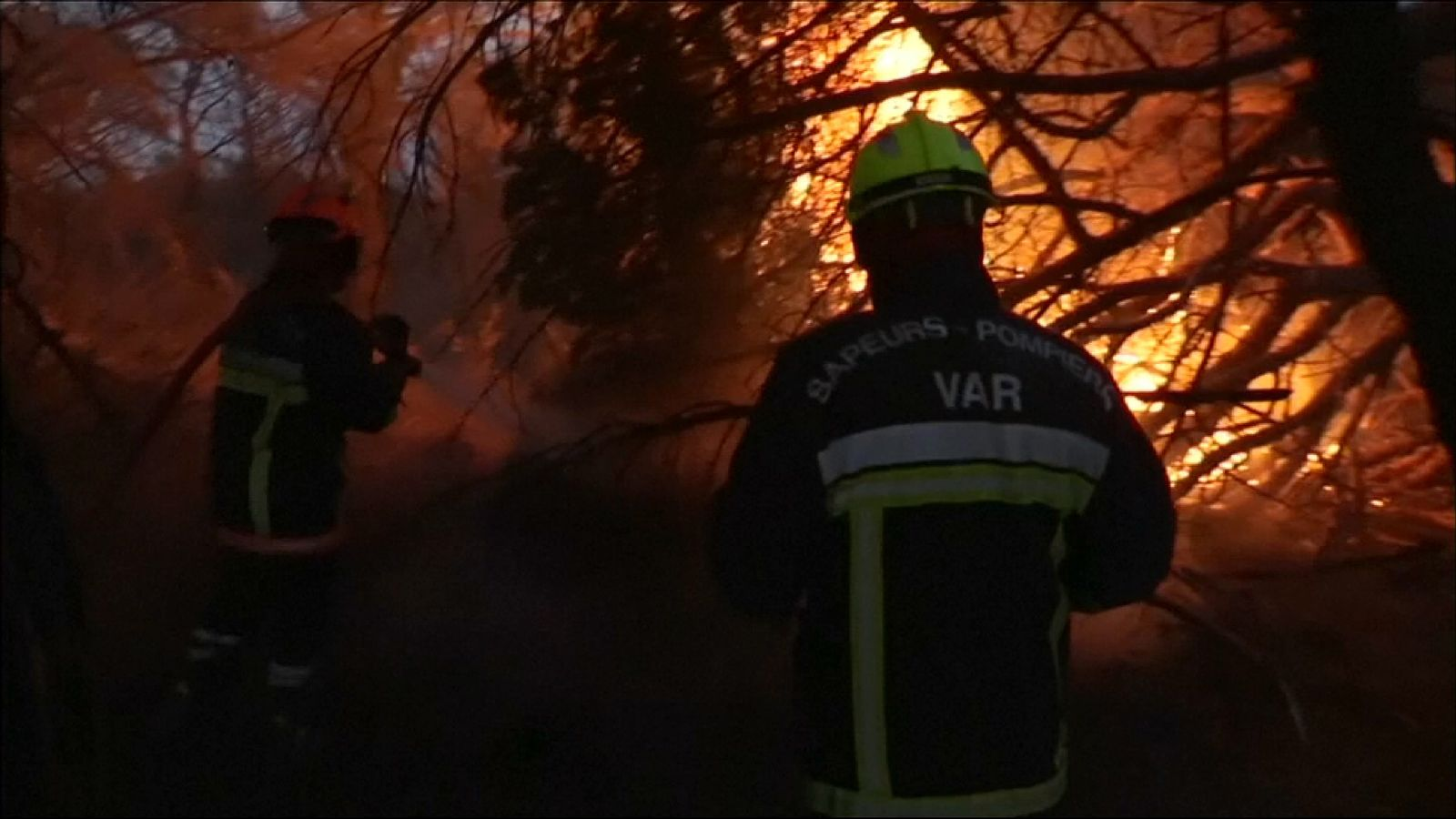 Firefighters battle to contain forest fires in southern France