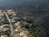 The fire devastated landscape in Biguglia, on the French Mediterranean island of Corsica