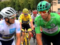 Setting off at the start of the final stage, Froome (centre) held a 54 second advantage