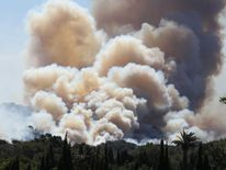 Smoke billows during a forest fire in La Croix-Valmer, near Saint-Tropez