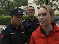 Katie Stallard is shoved away from Liu Xia's apartment in Beijing