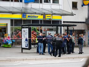Security forces are seen after a knife attack in a supermarket in Hamburg, Germany, July 28, 2017. REUTERS/Morris Mac Matzen