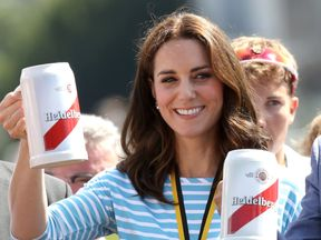 The Duchess of Cambridge was commiserated with a beer after she lost the race to her husband