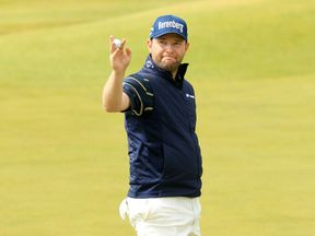 South African Branden Grace celebrates his record-breaking round at The Open