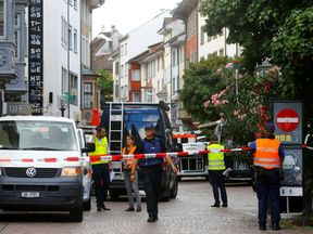 Swiss police officers stand at a crime scene in Schaffhausen, Switzerland