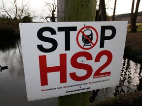 A duck swims past a HS2 protest sign in Little Missenden, south-west England, January 9, 2012