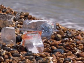 Litter on a pebbled beach