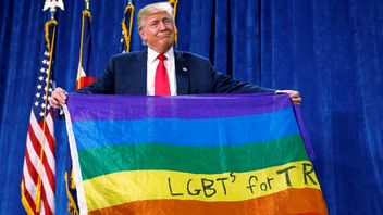 "Republican presidential nominee Donald Trump holds up a rainbow flag with ""LGBTs for TRUMP"" written on it at a campaign rally in Greeley, Colorado, U.S. October 30, 2016. REUTERS/Carlo Allegri TPX IMAGES OF THE DAY"