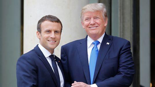 Emmanuel Macron greets Donald Trump in Paris