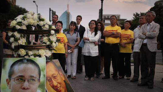 People gather together during a vigil in memory of Chinese Nobel Peace Prize laureate Liu Xiaobo on July 17, 2017 in Washington, DC. Liu, 61, died of multiple organ failure on July 13, 2017 as he was serving a 11-year prison term in China for the act of inciting subversion of state power