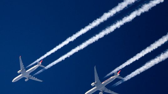 Commercial airliners in the sky above London