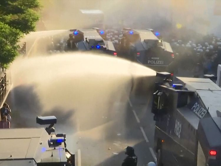 Water cannon are used by police on protesters in Hamburg ahead of G20 summit