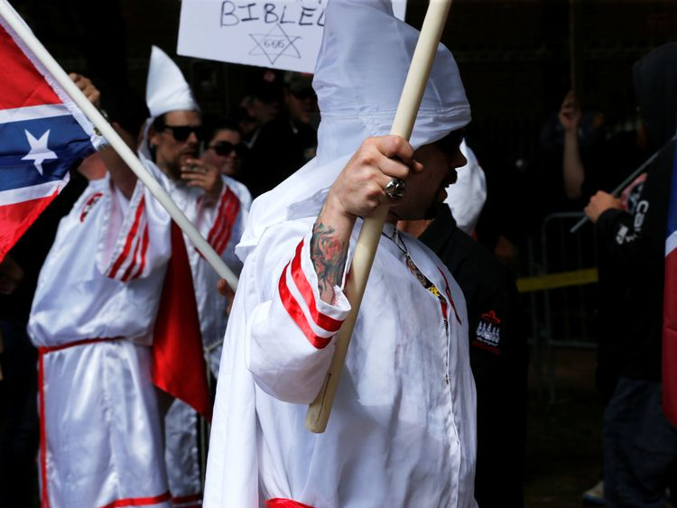 Members of the Ku Klux Klan rally in opposition to city proposals to remove or make changes to Confederate monuments in Charlottesville