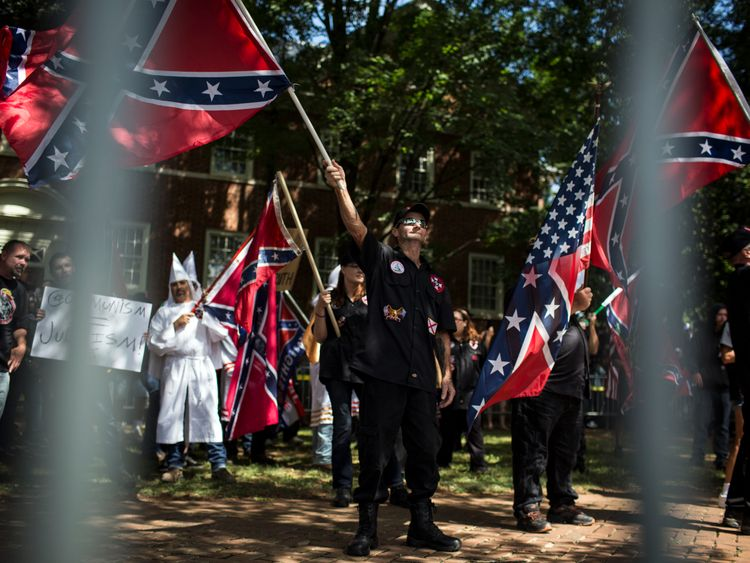 Klan members and their supporters waved Confederate flags