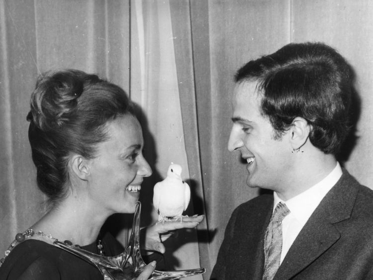 French actress Jeanne Moreau and director Francois Truffaut with the awards they received for the classic film Jules et Jim