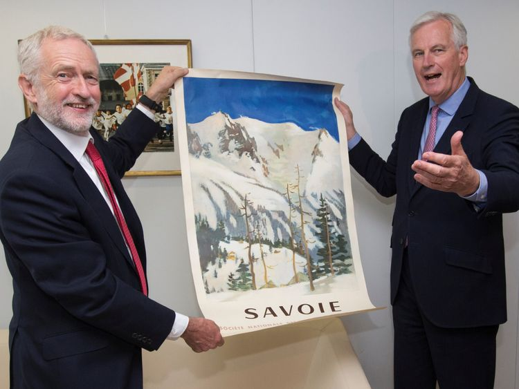 Jeremy Corbyn and Michel Barnier pose with a poster of French Savoie region during a meeting in Brussels