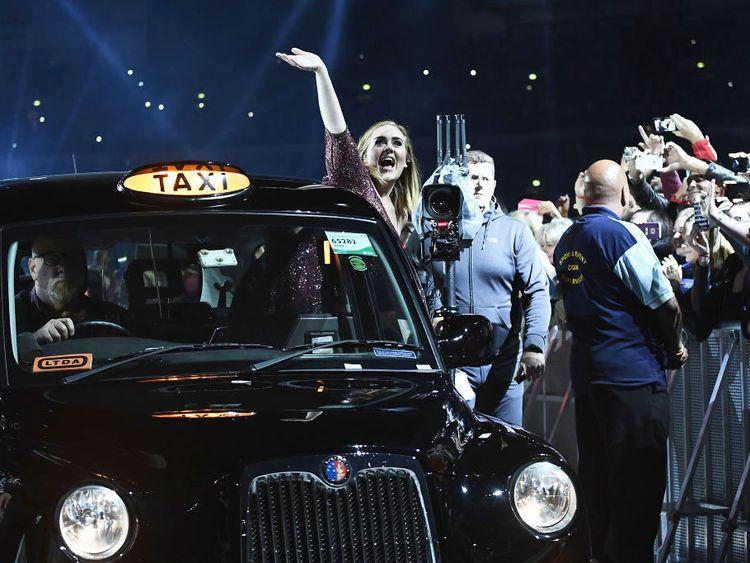 Adele performs at Wembley Stadium