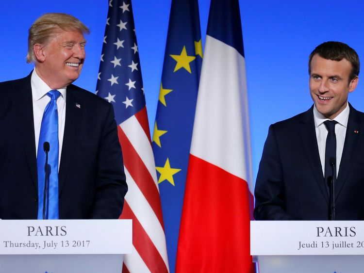 Donald Trump and Emmanuel Macron smile at a joint press conference