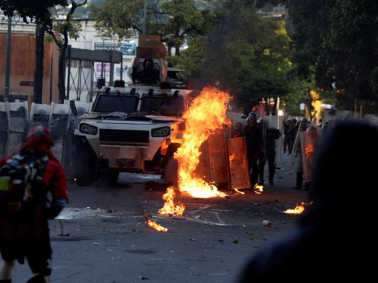 A riot security forces vehicle is set on fire
