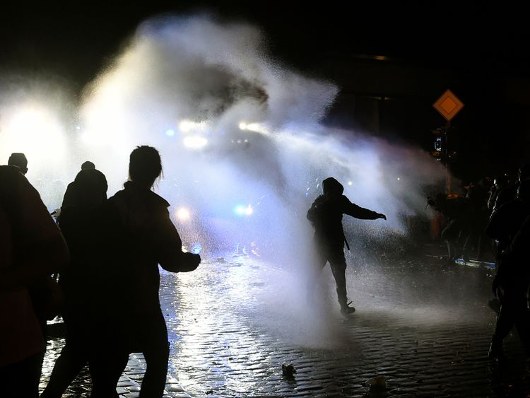 The police use water cannons during riots on July 8, 2017 in Hamburg, northern Germany, after the leaders of the world's top economies gathered for a G20 summit. German police and protestors had clashed already the day before at an anti-G20 march, with police using water cannon and tear gas to clear a hardcore of masked anti-capitalist demonstrators