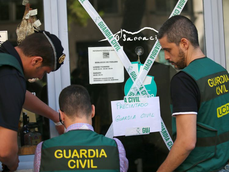 Spanish Guardia Civil officers cordon off a restaurant in Barcelona