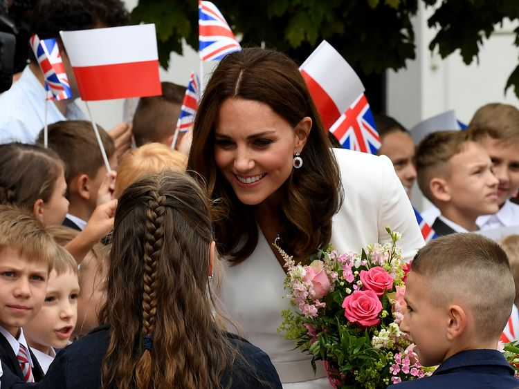 Kate chats to children outside the presidential palace in Warsaw