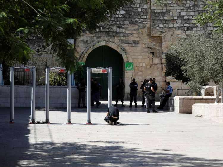 DATE IMPORTED:16 July, 2017A man installs metal detectors at an entrance to the compound known to Muslims as Noble Sanctuary and to Jews as Temple Mount, in Jerusalem's Old City July 16, 2017. REUTERS/Ronen Zvulun