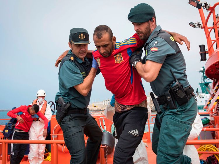Spanish police rescuing migrants in Gibraltar in June