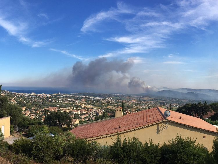 Smoke rises from the wildfire in Bormes les Mimosas, France