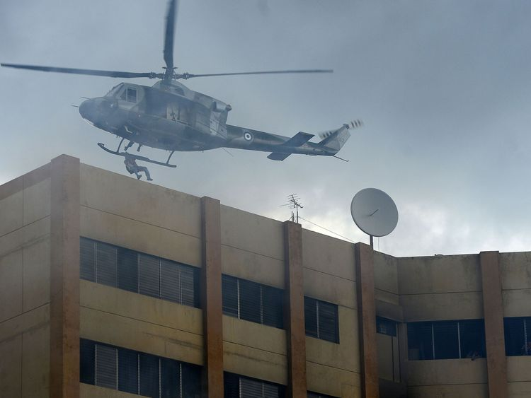 A military helicopter rescues people trapped on the roof of the Ministry of Finance by an intense fire in San Salvador, on July 7, 2017