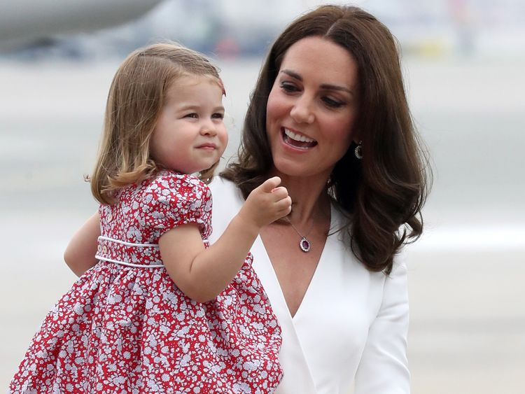 The Duchess of Cambridge carries Princess Charlotte