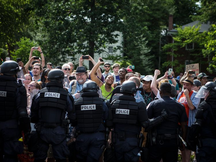 Counter protesters are held back by riot police as the Ku Klux Klan leaves a staged rally on July 8, 2017 in Charlottesville, Virginia