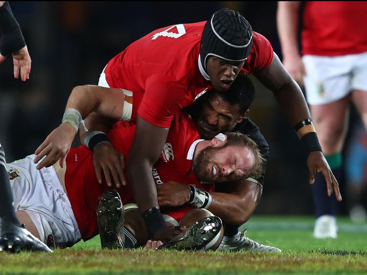 Alun Wyn Jones of the Lions is felled by a high tackle from Jerome Kaino