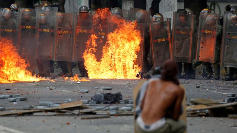Demonstrators clash with riot security forces at a rally during a strike to protest against Venezuelan President Nicolas Maduro's government in Caracas