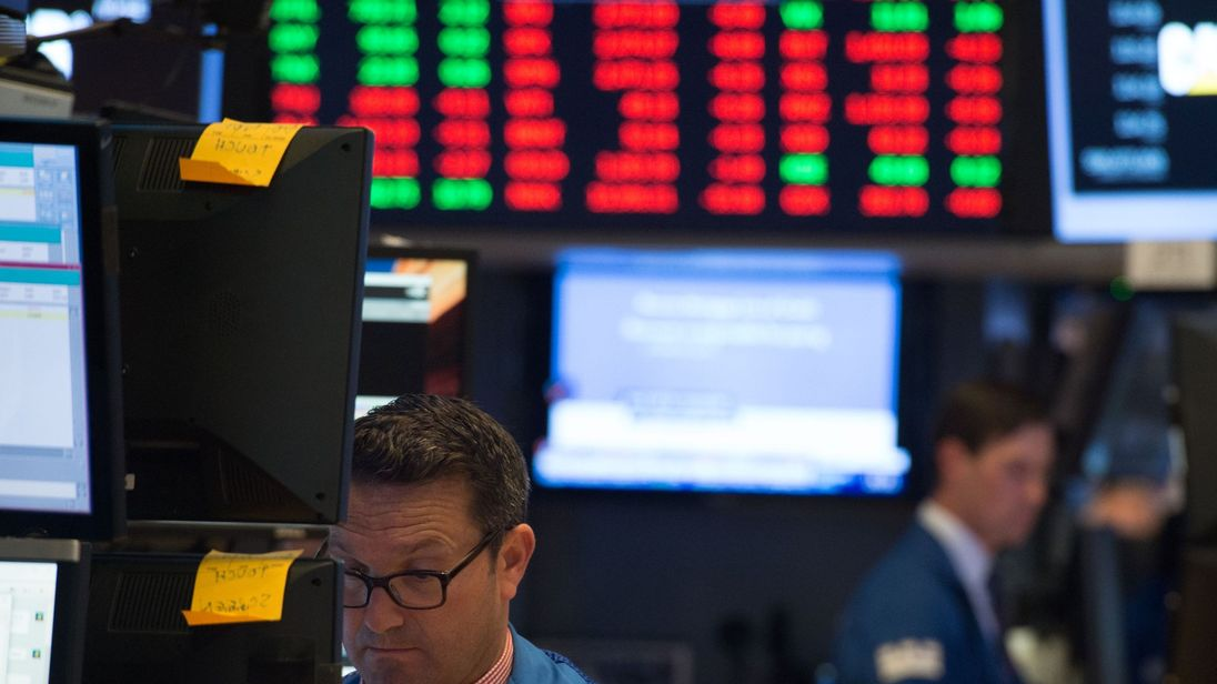 A trader works on the floor at the closing bell of the Dow Industrial Average at the New York Stock Exchange
