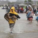 People evacuating their homes after flooding caused by Hurricane Harvey