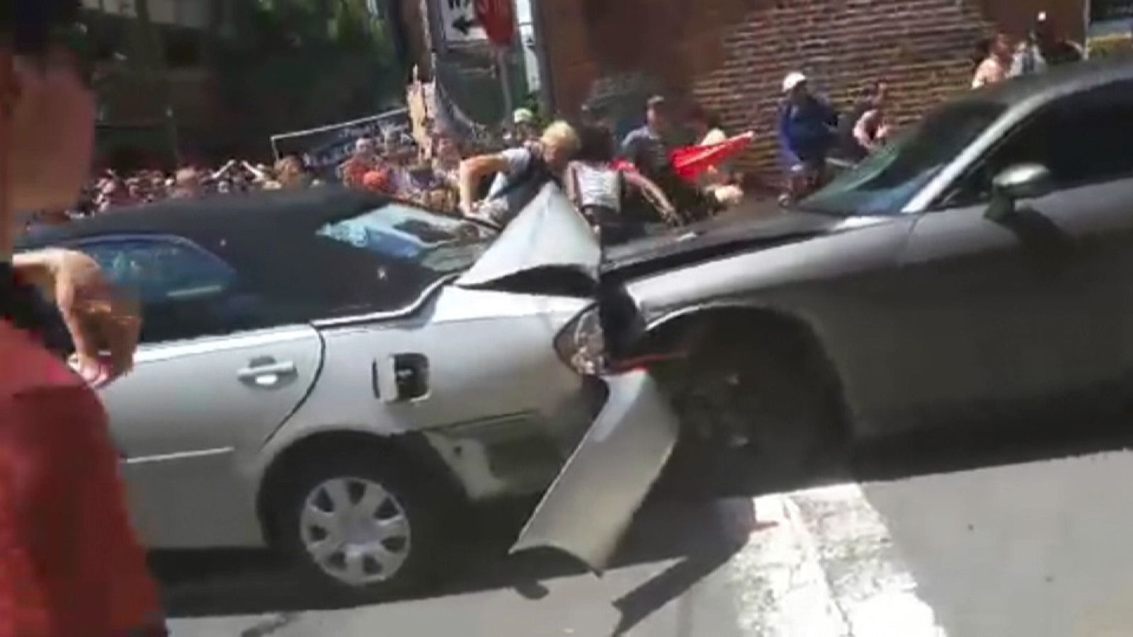 Car sends counter-protesters flying