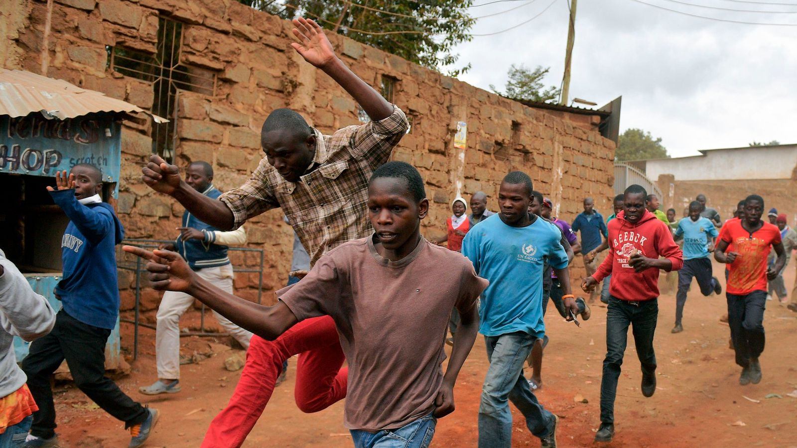 Protesters run divided after demonstration military dismissed live rounds in a Kibera dive in Nairobi