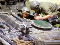 June 1988: Diana in the driving seat of the 'Striker' tank, getting instructions from Sgt Chris O'Byrne on Salisbury Plain