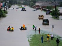 Volunteer rescuers evacuate people from a flooded residential area during the aftermath of Hurricane Harvey on August 29, 2017 in Houston, Texas. Floodwaters have breached a levee south of the city of Houston, officials said Tuesday, urging residents to leave the area immediately. / AFP PHOTO / Brendan Smialowski (Photo credit should read BRENDAN SMIALOWSKI/AFP/Getty Images)