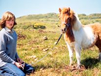 1974: Family album picture of Lady Diana Spencer with Souffle, a Shetland pony, at her mother's home in Scotland during the summer