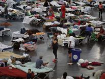 Evacuees taking shelter at the George R. Brown Convention Center  in Houston