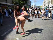 Revellers walk through Notting Hill Carnival