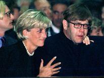July 1997: Diana comforts pop star Elton John as he weeps at a memorial mass for Italian Fashion King Gianni Versace in Milan