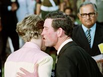 Feb 1992: Prince Charles kisses his wife Princess Diana after playing a game of polo with a local Rajasthan team in Jaipur, India