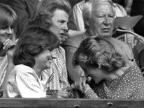 July 1985: Diana laughs with Carolyn Herbert in the Royal box at Wimbledon before the men's singles semifinal between Jimmy Conners and Kevin Curren