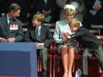 May 1995: The Prince of Wales, Prince William, Princess Diana and Prince Harry attend a ceremony in Hyde Park to commemorate the 50th Anniversary of VE Day