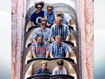 Aug 1993: Diana ducks whilst descending a log flume water ride, Splash Mountain, at Walt Disney World in Florida. Prince Harry is shown front left
